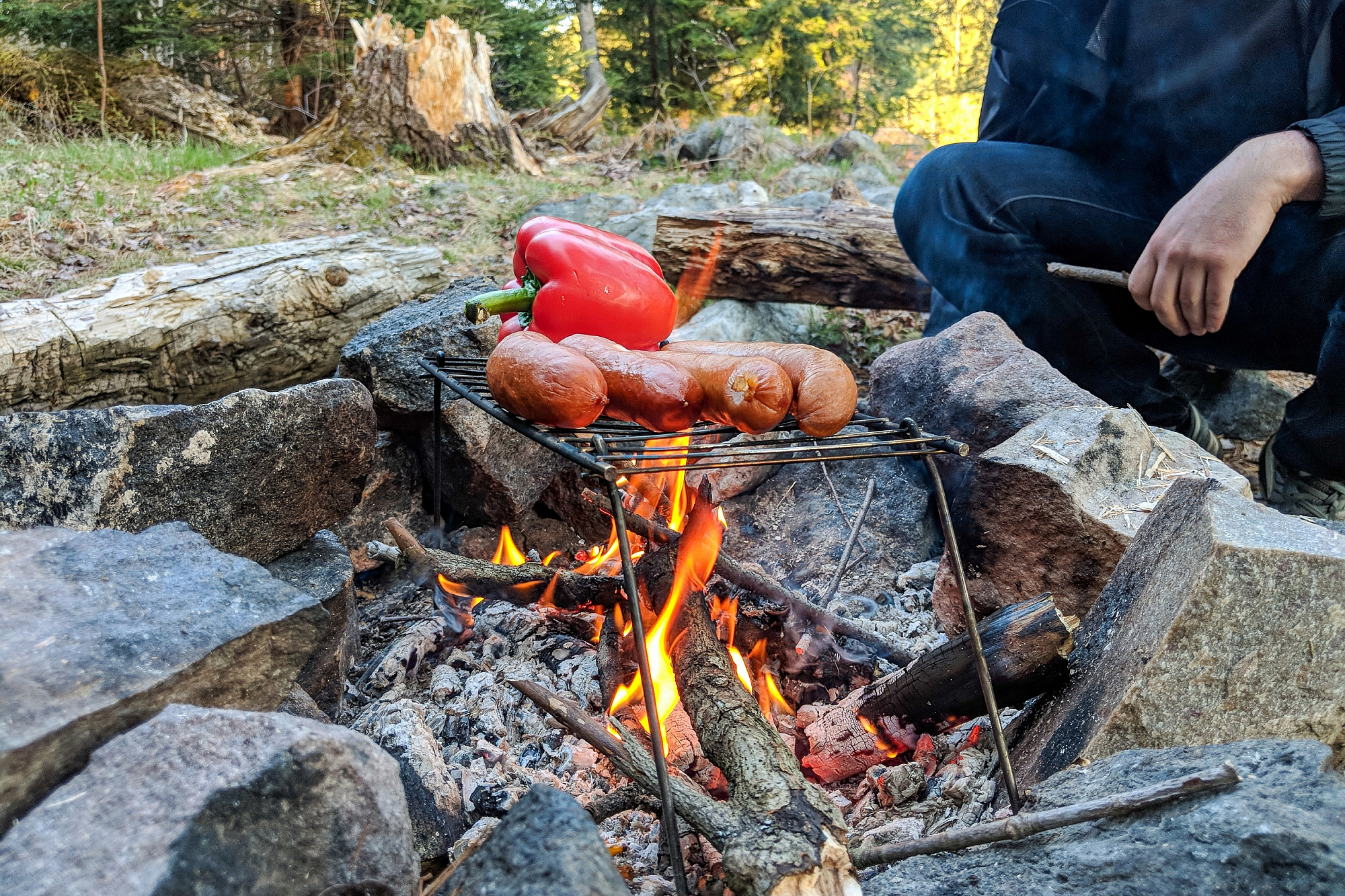 Sausage and pepper on an open fire